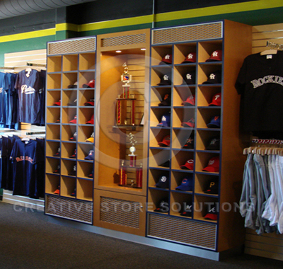 Sporting goods store baseball cap display cabinet.